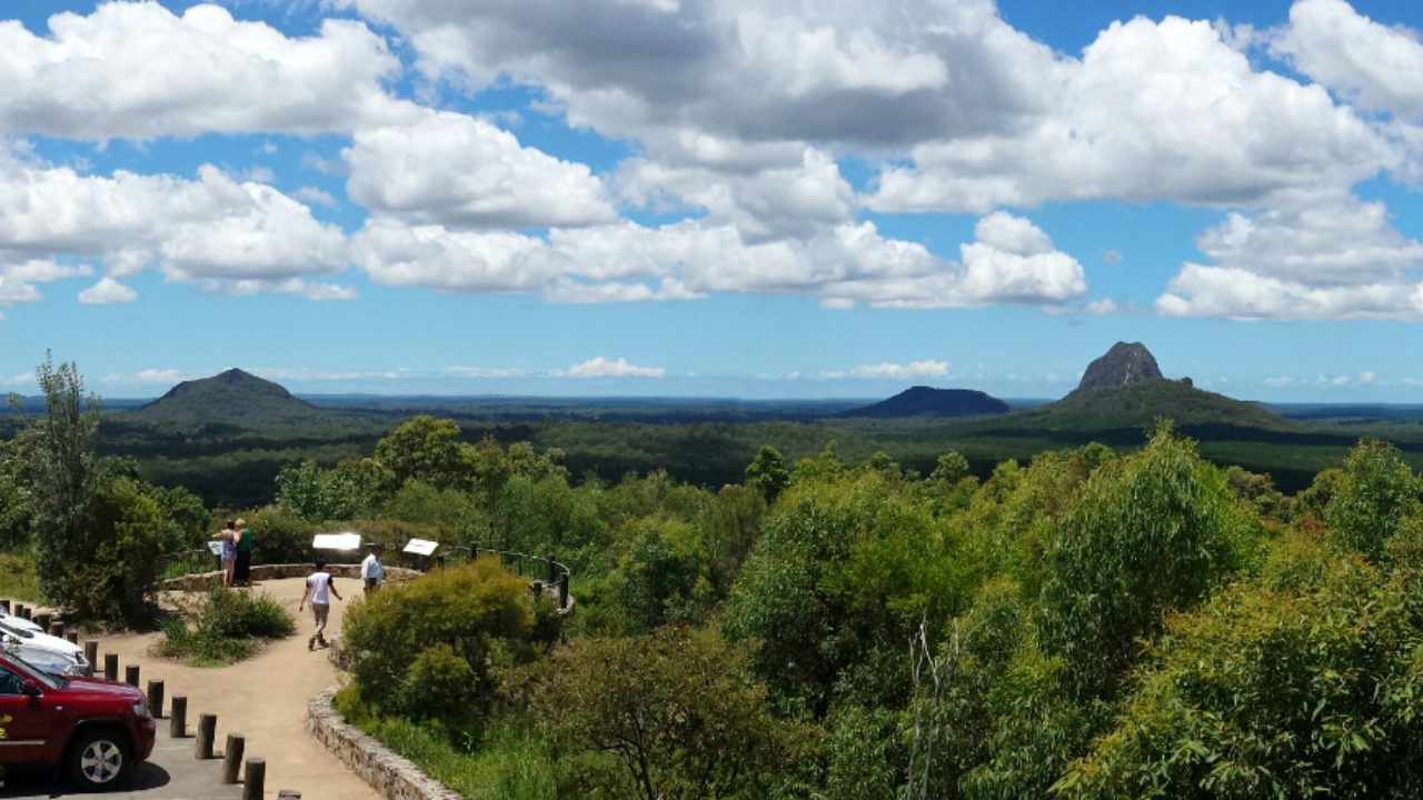 Sunshine Coast Hinterland, View of Glasshouse Mountains from lookout - Coast to Hinterland Tours