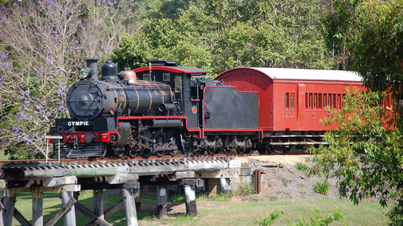 Gympie Day Tours, Mary Valley Rattler Steam Train crossing wooden bridge - Coast to Hinterland Tours